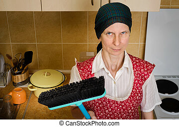 Portrait of Woman with a Broom in the Kitchen - An angry and...