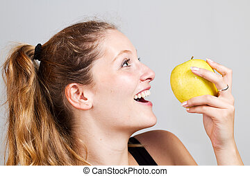 portrait of woman with apple