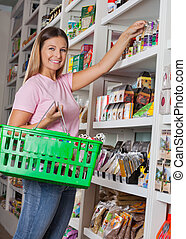 Portrait Of Woman With Basket Shopping In Grocery Store