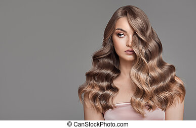 Portrait of woman with beautiful natural long wavy blonde hair