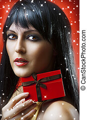 portrait of woman with christmas gift box