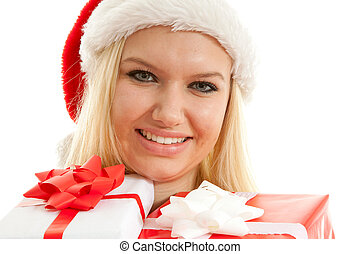 portrait of woman with christmas hat and presents
