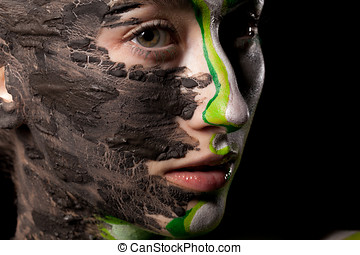 Portrait of woman with extravagant artistic make up on black bac