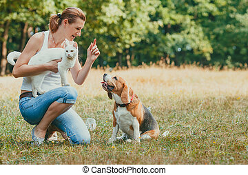 Portrait of woman with her pets outdoors
