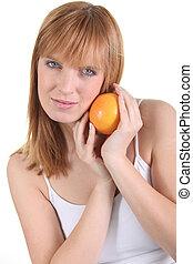 Portrait of woman with orange