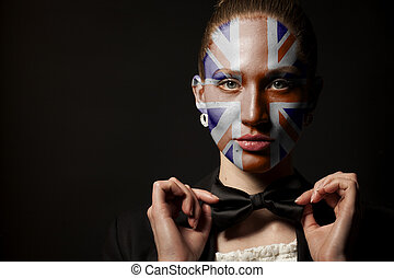 Portrait of woman with painted British Union Jack flag and bow tie