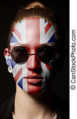 Portrait of woman with painted British Union Jack flag with sunglasses