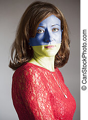Portrait of woman with painted Ukraine flag