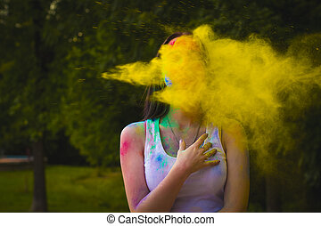 Portrait of woman with powder blowing on her face
