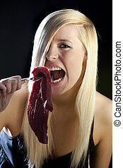portrait of woman with raw meat