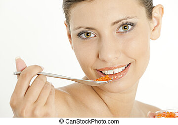 portrait of woman with red caviar