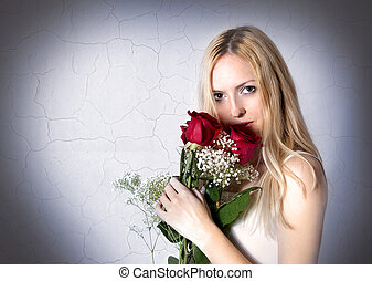 Portrait of woman with red roses