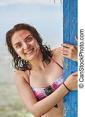Portrait of woman with sun cream