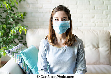 Portrait of woman with surgical mask - Pretty brunette woman...