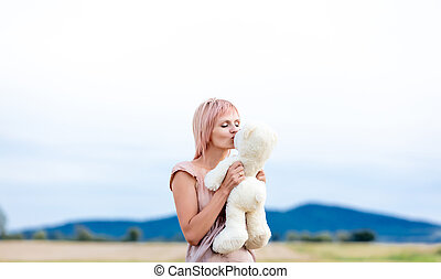Portrait of woman with teddy bear