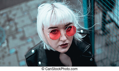 Portrait of woman with white hair and glasses. Modern urban style