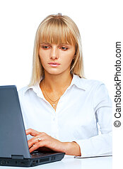 Portrait of woman working on a laptop