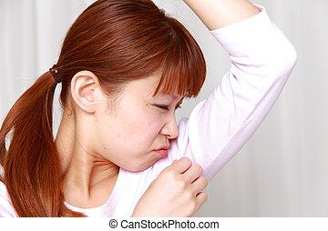 portrait of woman worrys about body odor