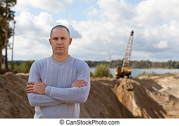 worker at sand pit