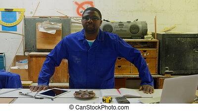 Portrait of worker posing in foundry workshop 4k - Portrait ...
