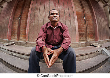 Portrait of worried adult asian man - Portrait of mid adult...