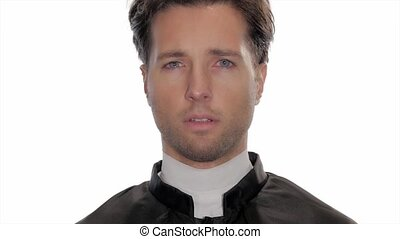 portrait of worried catholic priest - young clergyman is...