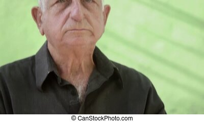 Elderly people and emotions, portrait of serious and sad senior caucasian man looking at camera. Sequence