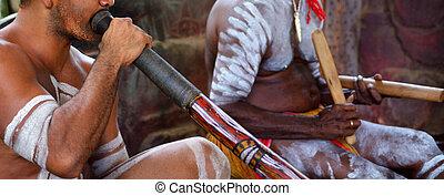 Portrait of Yirrganydji Aboriginal men play Aboriginal music...