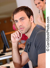 Portrait of young adult attending training class