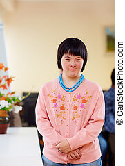 portrait of young adult woman with down's syndrome