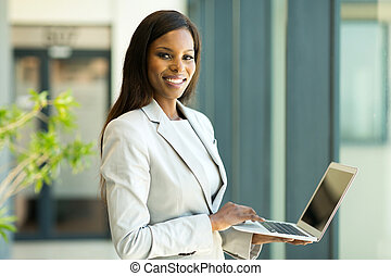 young african american business woman with laptop