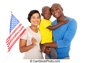 young african american family with a USA flag