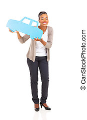 young african american woman holding a car symbol