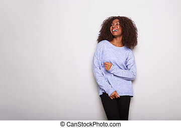 young african american woman laughing on white background