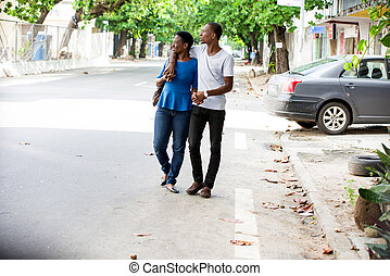 portrait of young african couple, smiling.