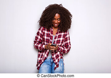 young african woman using mobile phone on white background