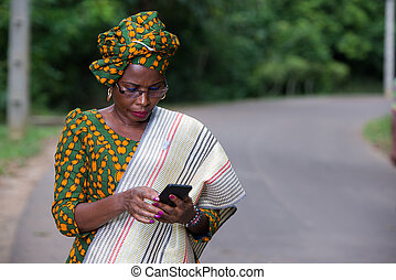 portrait of young african woman with mobile phone.