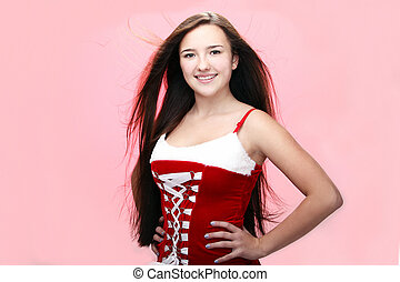 young and beautiful smiling christmas girl in red