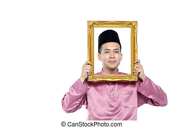 Portrait of young and handsome asian man with traditional...