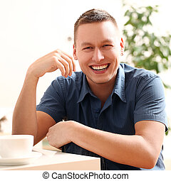 Portrait of young and happy smiling guy