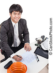 portrait of young architect working drawing perspective building