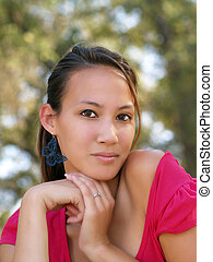 Portrait of young asian american woman with hands