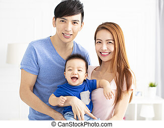 Portrait of young asian family with baby