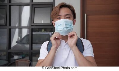 portrait of young asian highschool student wearing face mask before going to school or campus