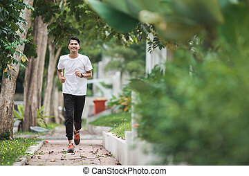 asian man running and exercising outdoor