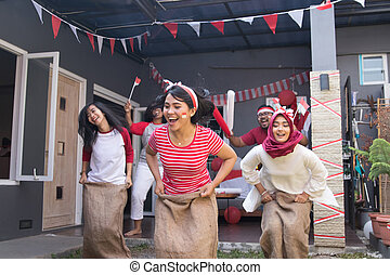 sack race during indonesia independence day