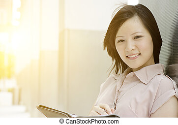 Portrait of young Asian woman executive