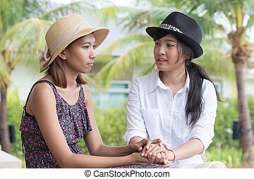 portrait of young asian woman friends talking to consult...