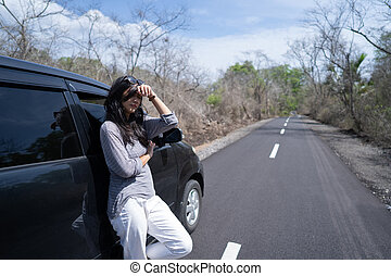 woman having problem with her car