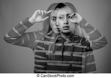 Portrait of young Asian woman wearing hoodie